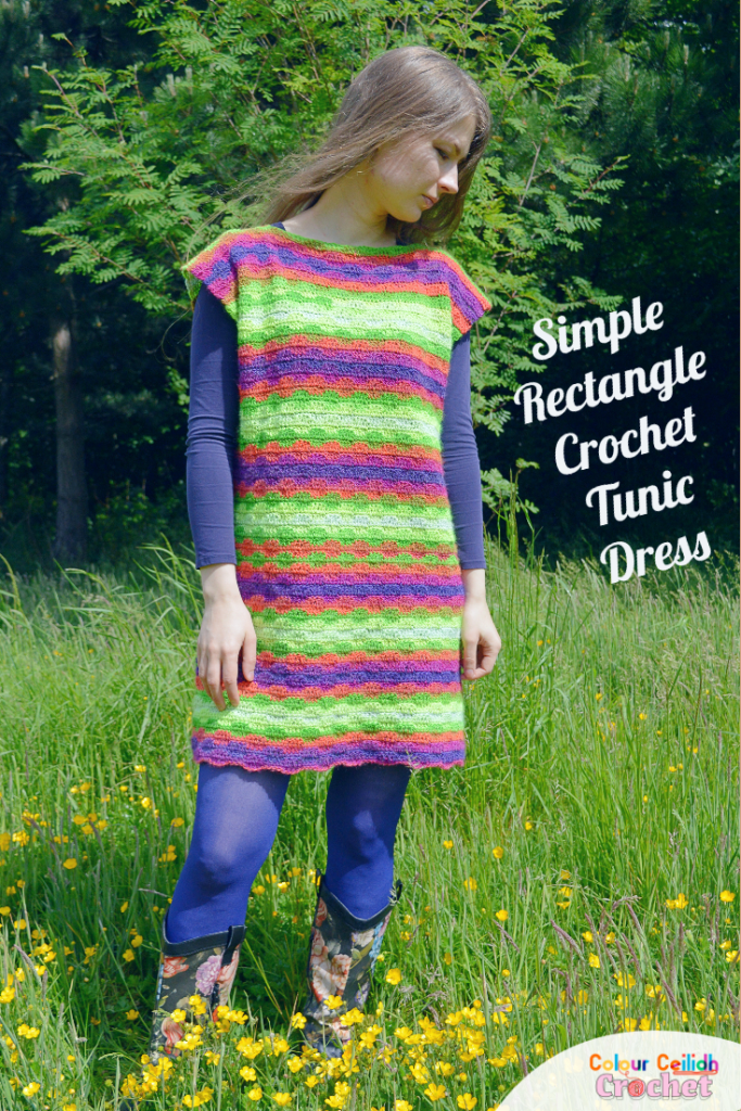 This crochet tunic dress pattern with sleeves is a simple rectangle seamed at the sides and shoulders. Click for the free pattern and diagram. This easy beginner crochet tunic dress only uses single and double crochet stitches to create a subtle wavy stitch pattern to make the usual stripes a little more interesting. I love the super simple shape which looks great as is or you could belt it too. I love how it frames my shoulders and creates loose fitting comfortable sleeves without even trying.