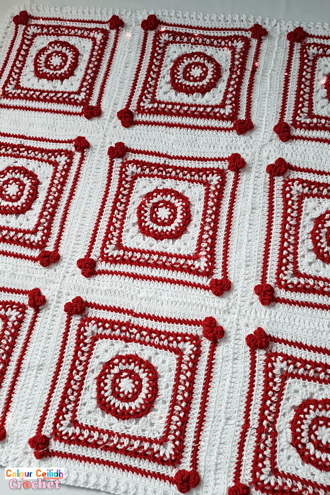 This Christmas crochet blanket pattern is a Scandinavian style afghan with bobble hearts and eight-pointed Nordic stars. Using worsted weight yarn I combine two bold red and white colors for maximum effect to instantly set the Christmas atmosphere. This free pattern includes a YouTube video tutorial. Matching Scandinavian style crochet baubles are available as a separate pattern.