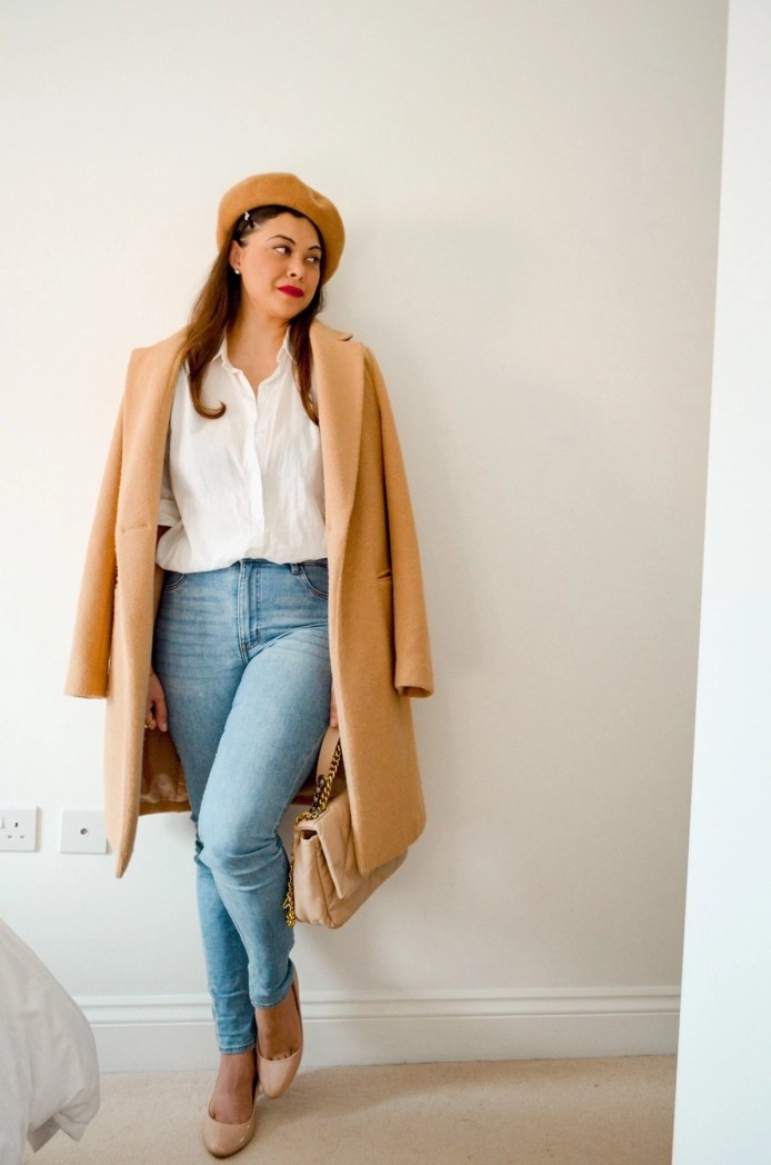 Camel coat and beret with classic white shirt and blue jeans