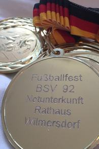 Medals for participants in the Germany refugee soccer tournament.