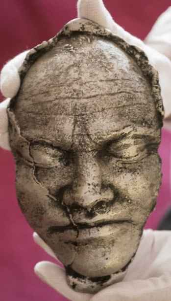 """In the mid-70s, North Carolina sculptor William Dunlap made this aluminum life mask of James Dickey. Dickey appeared, wearing a replica of the mask on his face, on the February 1976 cover of Esquire magazine. The first chapter of his second novel, """"Alnilam,"""" was excerpted in the same issue. Dickey claimed that chemicals from the cast used to make the mask had seeped into his eyes and rendered him temporarily blind. His """"blindness"""" was later heavily disputed, but Dickey said the experience inspired """"Alnilam,"""" which is about a blind man searching for his son."""