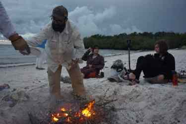 Director of Outdoor Education James Dick gets a campfire going on the beach during the Everglades trip.