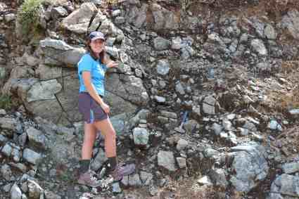 Chantal Iosso looks for good samples for geology research in Crete, Greece.