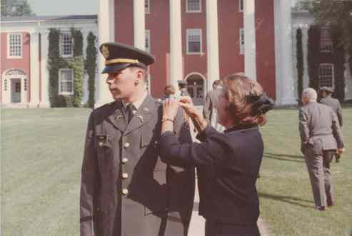 Jim Oram's mother pins on his lieutenant's bars on the W&L front lawn on Commencement Day 1967.