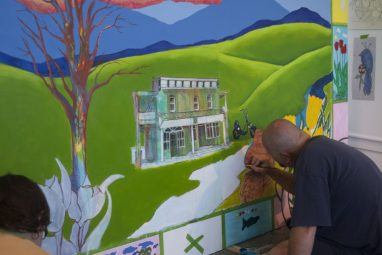 The Eagle's Nest Clubhouse featured prominently on the mural.