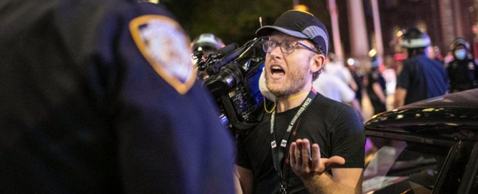"Associated Press videojournalist Robert Bumsted reminds a police officer that the press are considered ""essential workers"" and are allowed to be on the streets despite a curfew, Tuesday, June 2, 2020, in New York. Photo: Associated Press"