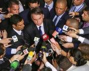 Journalists surround Brazil's President Jair Bolsonaro at the Planalto presidential palace in Brasilia, Brazil, in this 2019 file photo. Photo: The Associated Press