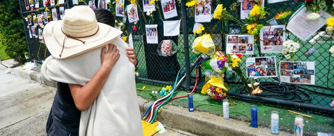 People embrace at a makeshift memorial outside St. Joseph Catholic Church in Surfside on Monday, June 28. Photo: The Associated Press