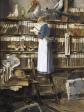 «Sirvienta leyendo en la biblioteca» (c. 1915), de Édouard John Mentha.