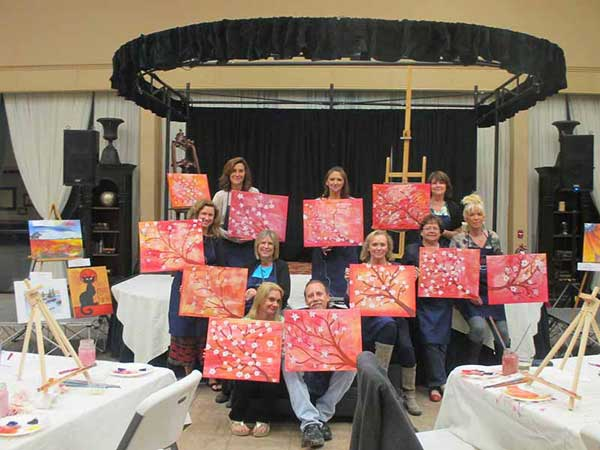 Everyone shows off paintings at end of class
