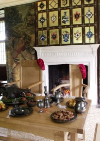 The Tudor Parlour, c.1560, at Avebury Manor, Avebury, Wiltshire. The table is laid with Pewtor ware which became increasingly more poppular amongst the well-to-do than wood fashioned table ware.