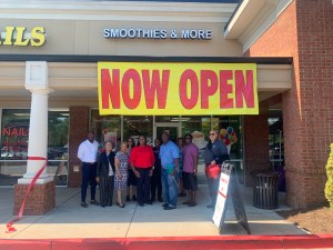 People standing outside business just after cutting ribbon