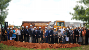 Group of businesspeople at groundbreaking ceremon