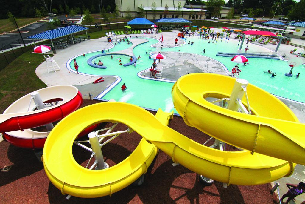Large red and yellow water slides ending in a pool.