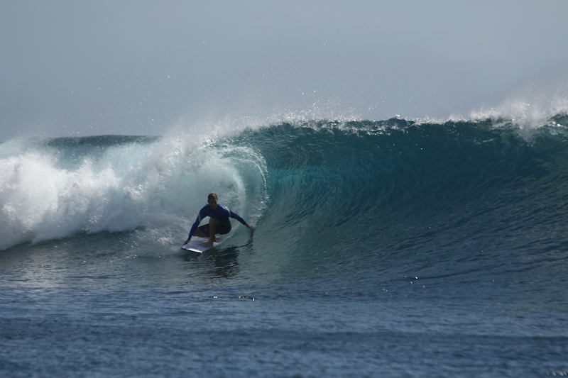 Founder George Hirst Surfing Indonesia with a hernia