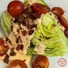 A wedge salad with bacon and a homemade chipotle ranch dressing.