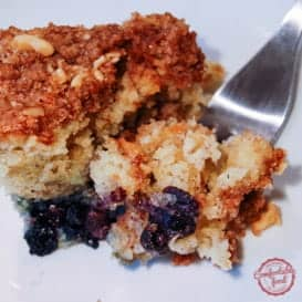 A rich dense Coffee Cake with sour cream and blueberries.