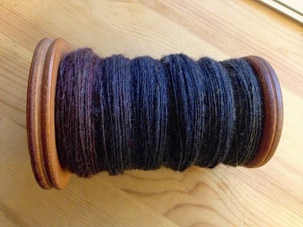 My full bobbin of beautiful hand painted roving, spun into a single ply yarn.