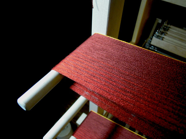 A warp developing on the warping board.