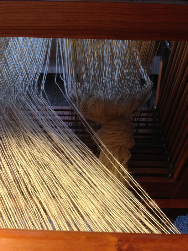 The warp after being re-sleyed, and removing the unnecessary warp threads.