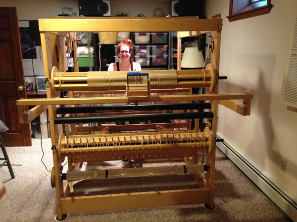 Me sitting at the new loom in it's temporary home.