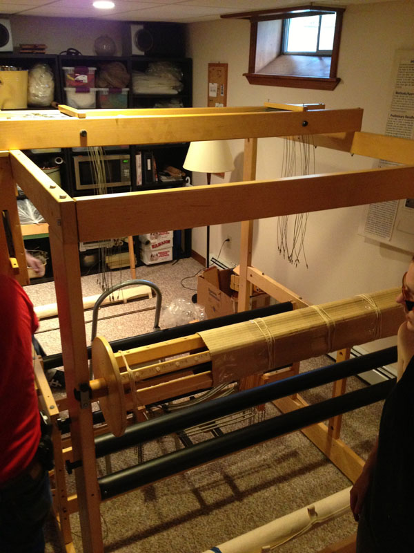 Taking a breather before attaching the second warp beam. The beams are easily removable. One is sectional and the other has been modified to weave narrower warps.