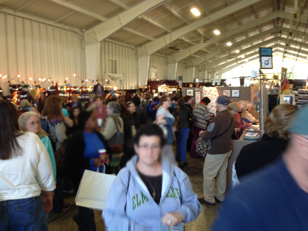 The first barn that we walked through. I turned around and took a picture of the maddening crowd. So much yarn! So little time.