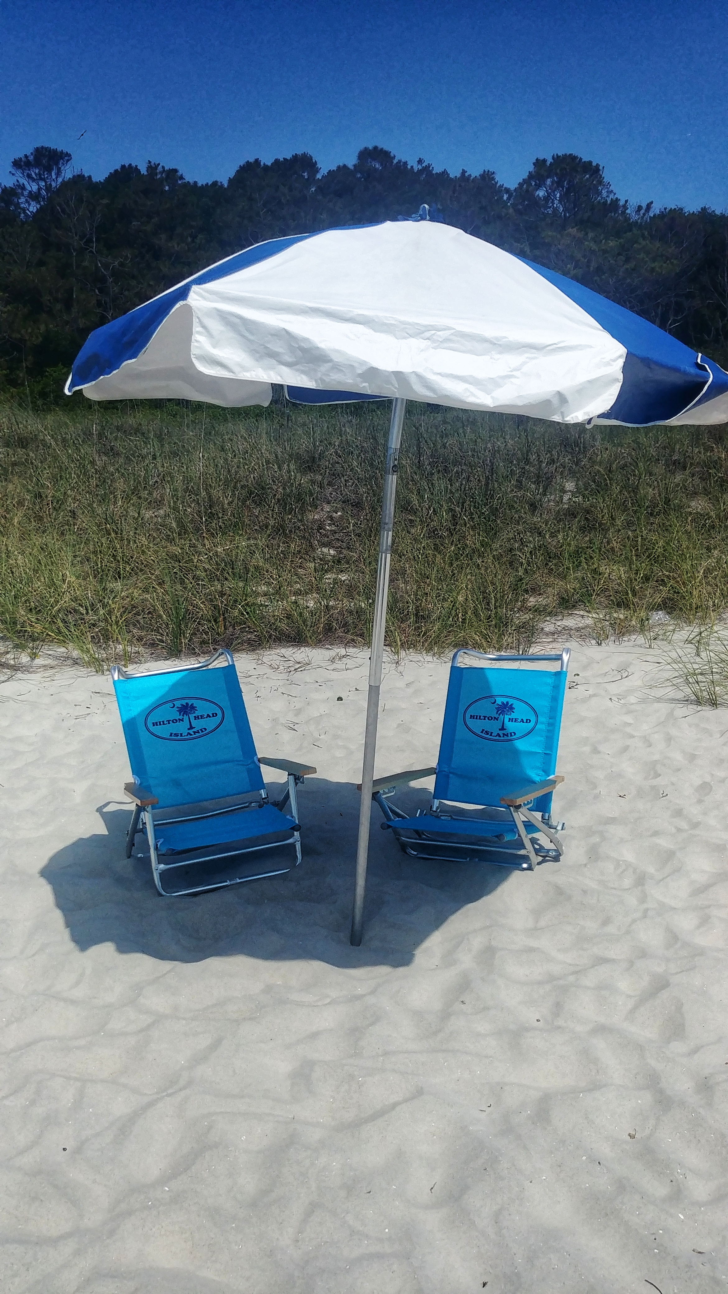 Chair With Umbrella Beach Umbrella Chair Combo At Vacation Comfort Rentals Hilton