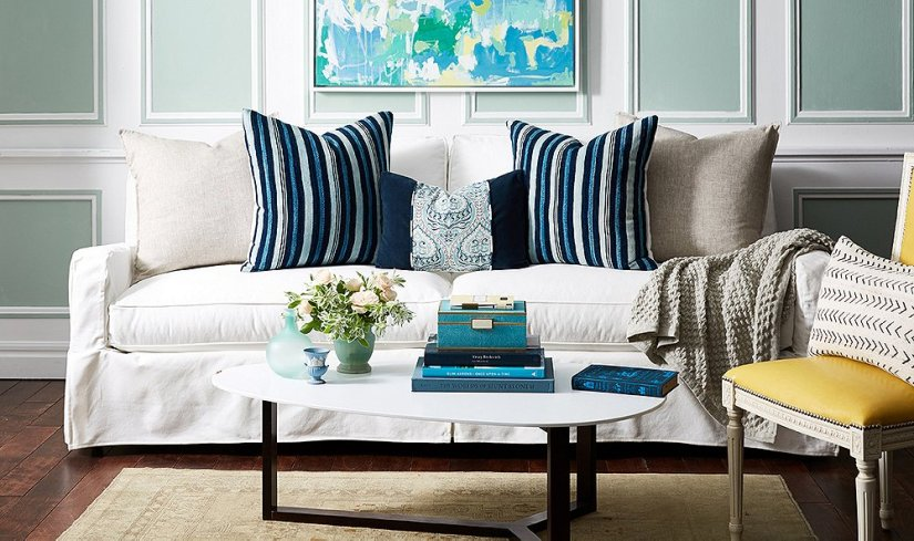 Mismatch pillow arrangements on couch is trendy