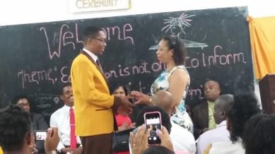 Dontae receiving his plaque