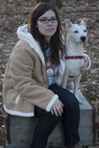 Kristen Gudsnuk and her coat-eating henchdog