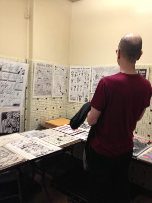 Charles Burns admiring the Scott Eder Gallery table