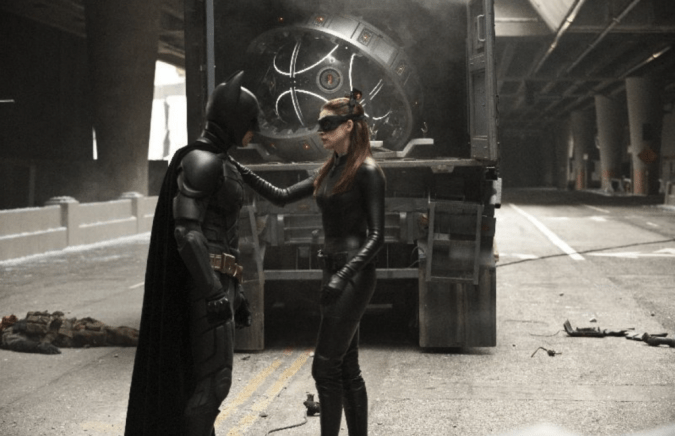 Christian Bale as Batman and Anne Hathaway as Catwoman
