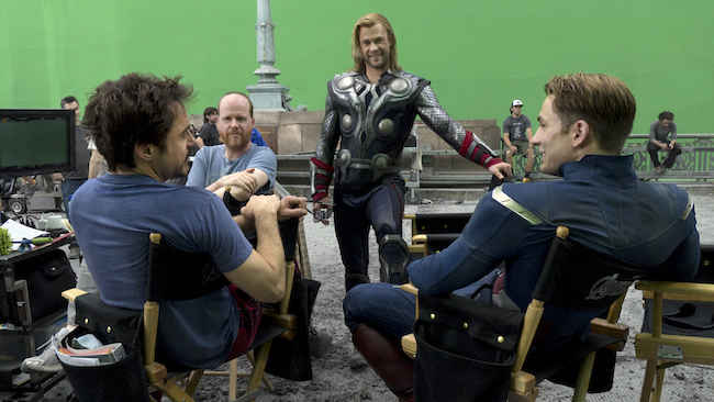 Robert Downey, Jr., Joss Whedon, Chris Hemsworth, and Chris Evans on the Avengers set