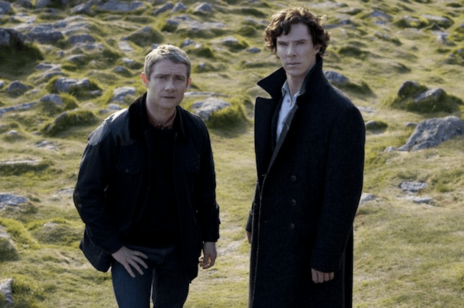 "Watson (Martin Freeman) and Holmes (Benedict Cumberbatch) on the moors in ""The Hounds of Baskerville"""