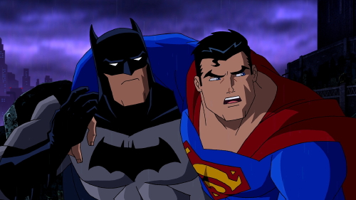 Batman helps a wounded Superman