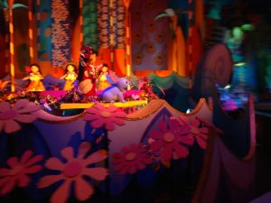 Lilo and Stitch surfing in the islands in It's a Small World