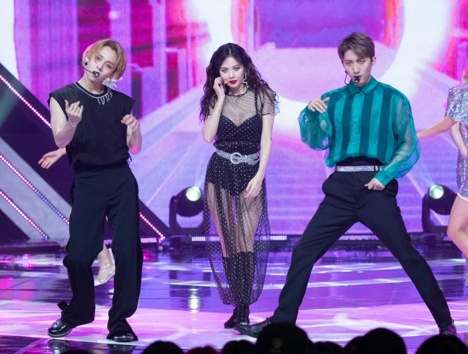 From left to right: E'Dawn, HyunA, and unidentified
