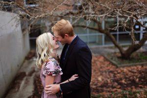 smiling-couple-standing-near-bare-tree-outdoors-macro-shot-667209