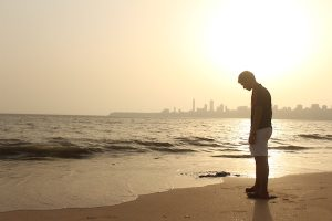 man-standing-on-seashore-1462641