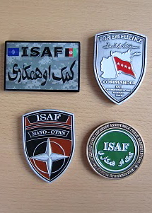 All four variants of the COMISAF Challenge Coin