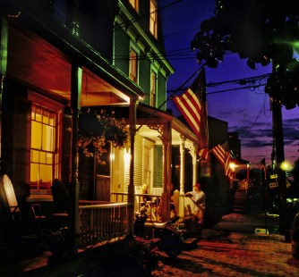 Late summer dusk falls on Maryland, Market, and Shipwright Streets, Annapolis, Maryland. Original: Ektachrome SW; Camera: Nikon FM3a; Lens: Nikkor 35-70mm; Exposure: f/5.6 Auto; Scanner Nikon LS 5000.