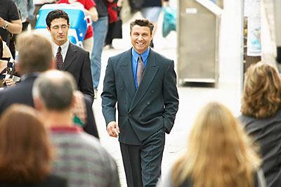 two business men walking in city street