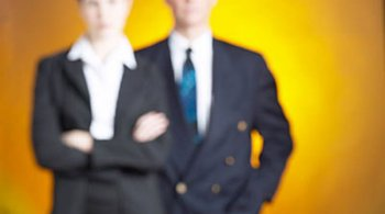 business man and woman in blur