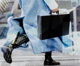 business man walking in street with briefcase