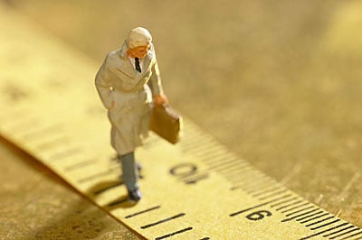 man walking on ruler