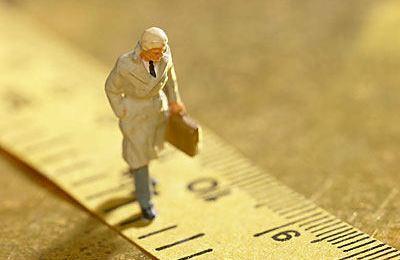 man walking on ruler