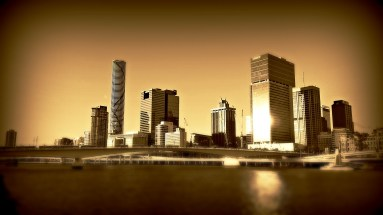 city buildings by river