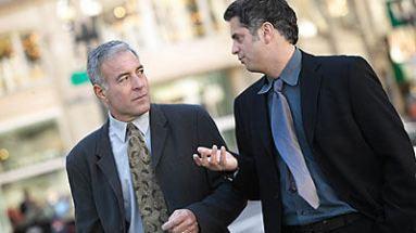business men talking and walking