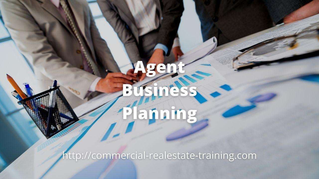 real estate agents planning on desk
